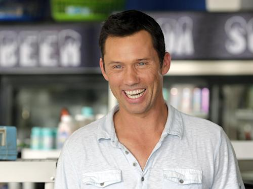 "In this July 24, 2013, photo, Jeffrey Donovan laughs on set during taping for an episode of ""Burn Notice"" in Miami. The cable spy drama is coming to an end after seven seasons with a big finale next Thursday, Sept. 12, 2013. (AP Photo/Alan Diaz)"