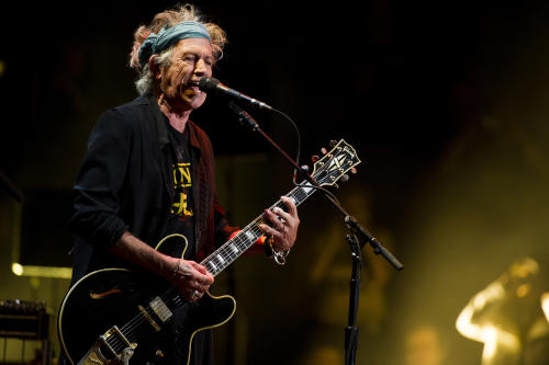 "FILE - This April 13, 2013 file photo shows Keith Richards performing at Eric Clapton's Crossroads Guitar Festival 2013 at Madison Square Garden in New York. Keith Richards says he doesn't own an iPod.The 69-year-old believes music lovers are ""all being short-changed"" with the sound that comes out of an iPod, launched in 2001. The Rolling Stones' ""50 & Counting Tour"" kicks off Friday in Los Angeles. (Photo by Charles Sykes/Invision/AP, file)"