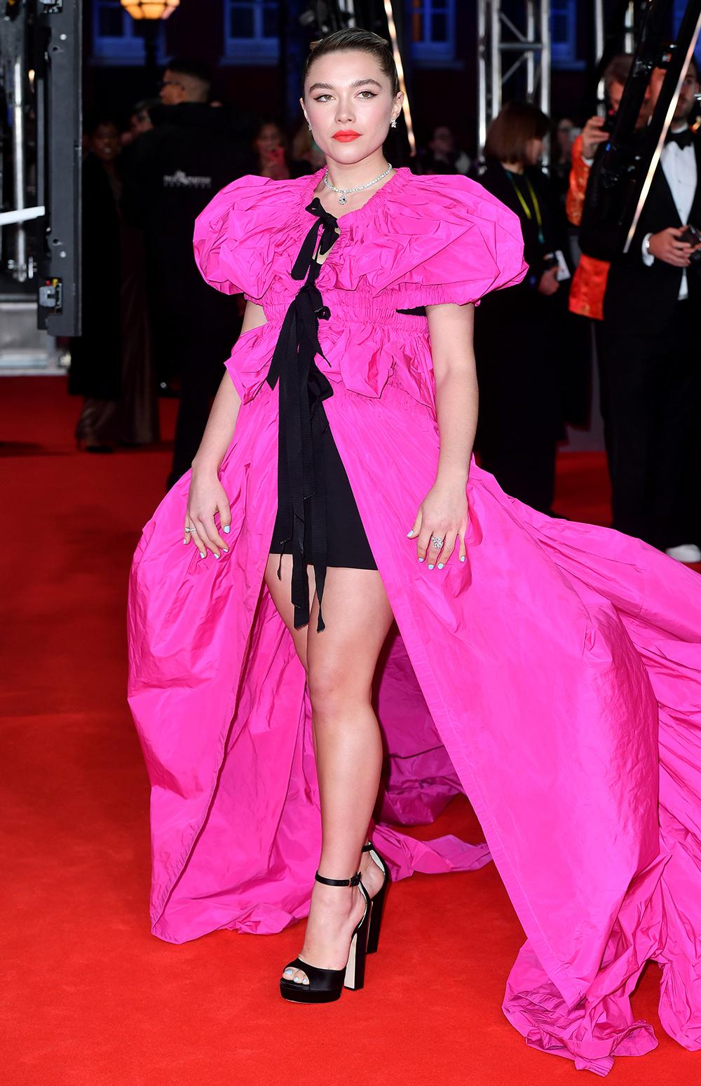 Florence Pugh wowed in a bright pink mini dress with a dramatic train [Image: PA]