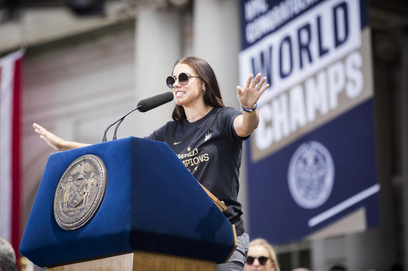 MANHATTAN, NY - JULY 10: Alex Morgan #13 of United States addresses the crowd during the ceremony on the steps of City Hall after the ticker tape parade down Broadway and through the through the Canyon of Heroes,. This celebration was put on by the City of Manhattan to honor the team winning the 2019 FIFA World Cup Championship title, their fourth, played in France against Netherlands, at the City Hall Ceremony in the Manhattan borough of New York on July 10, 2019, USA. (Photo by Ira L. Black/Corbis via Getty Images)