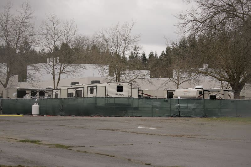 Recreational vehicles (RVs) are seen parked in an earmarked quarantine site for healthy people potentially exposed to novel coronavirus, behind Washington State Public Health Laboratories in Shoreline, north of Seattle