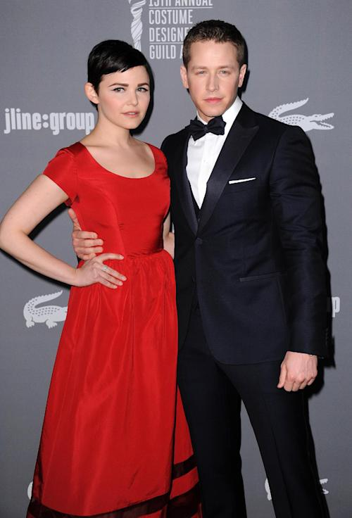 """FILE - This Feb. 19, 2013 file photo shows Ginnifer Goodwin, left, and Josh Dallas at the 15th Annual Costume Designers Guild Awards in Beverly Hills. The actors, both 35-years-old, who play Snow White and Prince Charming on ABC's """"Once Upon a Time,"""" have announced their engagement. The couple met while working on the show and began dating in 2011. Goodwin was previously engaged to actor Joey Kern, while Dallas used to be married to Lara Pulver from 2007-2011. (Photo by Jordan Strauss/Invision/AP, File)"""
