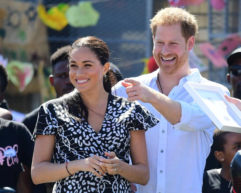 Prince Harry and Meghan Markle laugh in Africa