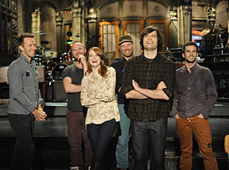 Emma Stone Hosts, But Headlines Dominate 'SNL'