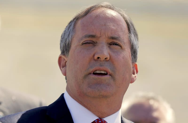 FILE PHOTO: Texas Attorney General Paxton speaks outside the U.S. Supreme Court after justices heard arguments over the constitutionality of President Obama's executive action to defer deportation of certain immigrants, in Washington