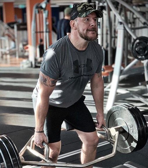 Manu Feildel at the gym lifting weights