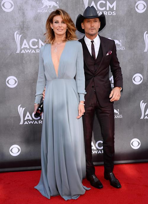Faith Hill, left, and Tim McGraw arrive at the 49th annual Academy of Country Music Awards at the MGM Grand Garden Arena on Sunday, April 6, 2014, in Las Vegas. (Photo by Al Powers/Powers Imagery/Invision/AP)