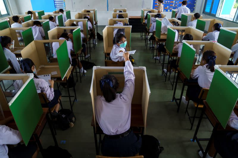 Schools reopen across Thailand with temperature checks, masks