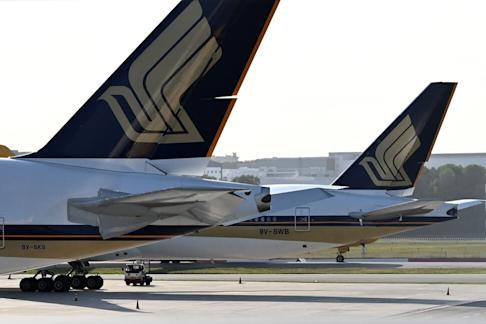 Singapore Airlines planes parked on the tarmac at Changi International Airport in Singapore on March 16, 2020. Photo: AFP