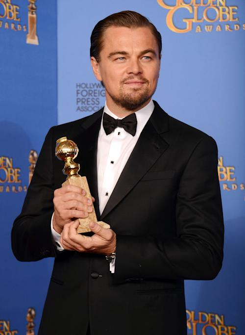 "Leonardo DiCaprio poses in the press room with the award for best actor in a motion picture - comedy or musical for ""The Wolf of Wall Street"" at the 71st annual Golden Globe Awards at the Beverly Hilton Hotel on Sunday, Jan. 12, 2014, in Beverly Hills, Calif. (Photo by Jordan Strauss/Invision/AP)"