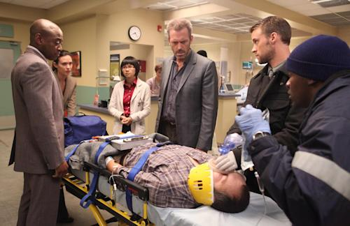 "In this image released by Fox, standing from left, Omar Epps, Odette Annable, Charlyne Yi, Hugh Laurie and Jesse Spencer are shown in a scene from the final season of ""House, M.D."" The Fox medical drama concludes its eight-season run on Monday, May 21, 2012, with a finale at 9 p.m. EDT, preceded by a one-hour retrospective. (AP Photo/Fox, Adam Taylor)"