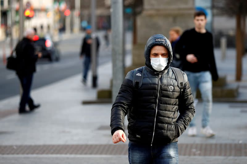 FILE PHOTO: A man wearing a face mask on St. Patrick's Day as public events were cancelled as the number of coronavirus cases grow around the world