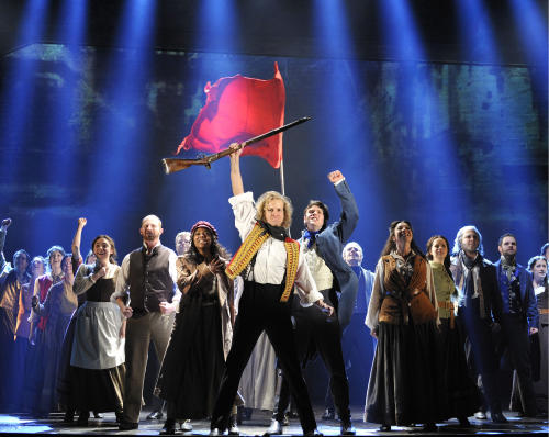 "FILE - This undated file photo provided by the Center Theatre Group shows the cast of Cameron Mackintosh's new 25th anniversary production of Alain Boublil and Claude-Michel Schönberg's ""Les Misérables."" Mackintosh said Thursday that the current U.S. tour of ""Les Miserables"" _ which began in 2010 and is currently in Sacramento, Calif. _ will land at New York City's Imperial Theatre, the show's former home on Broadway for nearly 13 years. (AP Photo/Center Theatre Group, Deen van Meer)"