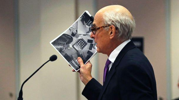PHOTO: Attorney Steven M. Gordon, who represents lottery winner 'Jane Doe', holds up an annual report from the New Hampshire Lottery during a hearing in the Jane Doe v. NH Lottery Commission case in Nashua, N.H., Feb. 13, 2018. (Charles Krupa/AP)