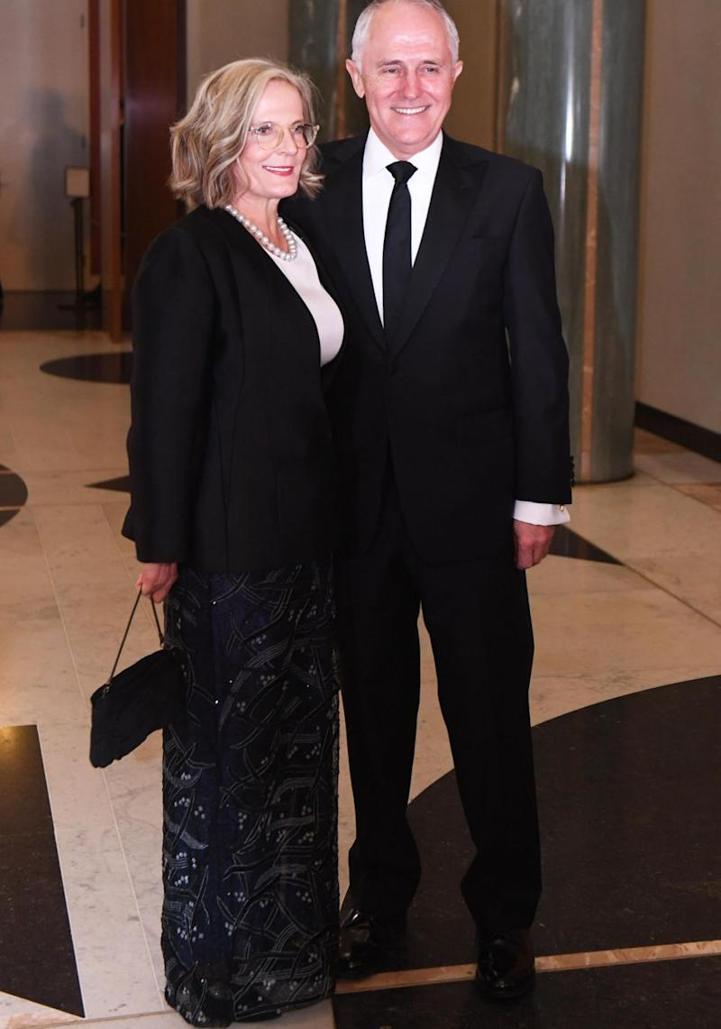 PM Malcolm Turnbull's wife, Lucy, went for a more understated look in a wearing a long embroidered black skirt with a smart black blazer and white top..