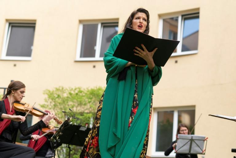 Monika Medek and the Camerata Carnuntum orchestra perform for guests during the 'window concert' at the Vienna hotel