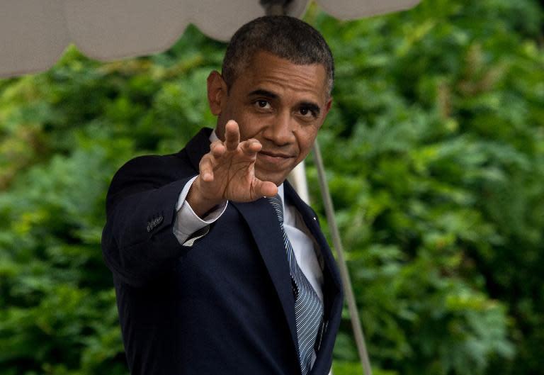 US President Barack Obama departing the White House in Washington on July 18, 2014