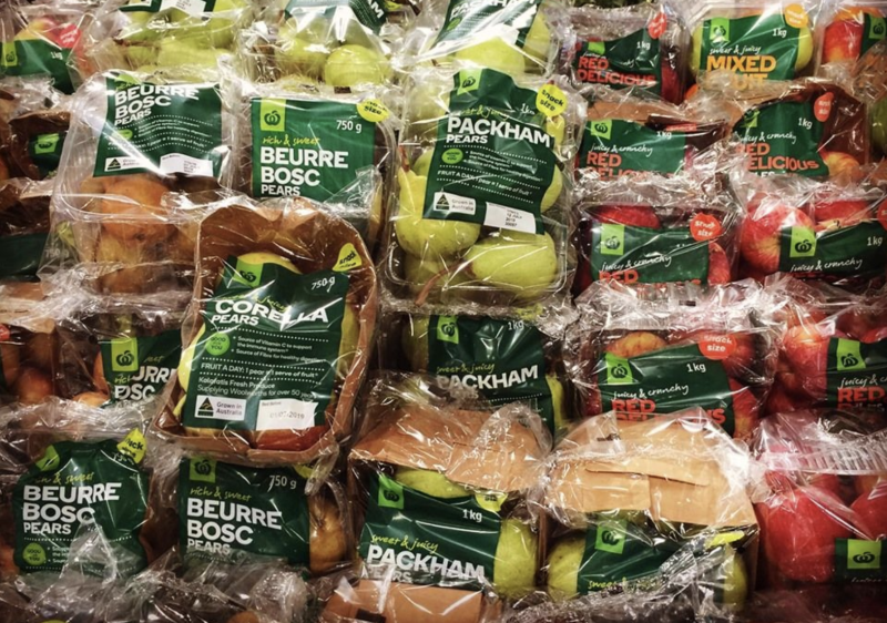Pictured is Woolworths fruit packaged in plastic bags in store.
