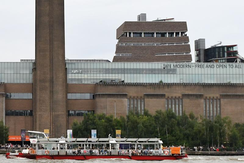 """A general view shows the Tate Modern gallery with its viewing platform rising above and behind the main building (C) on the southern bank of the River Thames in London on August 4, 2019 after it was put on lock down and evacuated after an incident involving a child falling from height and being airlifted to hospital. - London's Tate Modern gallery was evacuated on Sunday after a child fell """"from a height"""" and was airlifted to hospital. A teenager was arrested over the incident, police said, without giving any details of the child's condition. (Photo by Daniel SORABJI / AFP) (Photo credit should read DANIEL SORABJI/AFP/Getty Images)"""