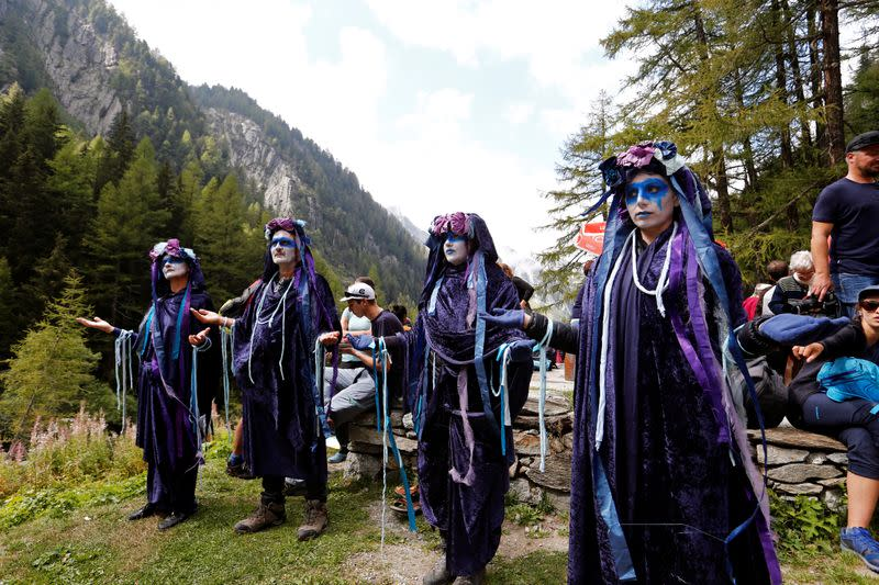 Climate activists gathered at Trient glacier mourn Switzerland's receding ice