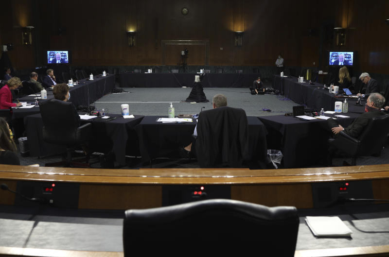 Dr. Robert Redfield, director of the Centers for Disease Control and Prevention, appears remotely during a virtual Senate Committee for Health, Education, Labor, and Pensions hearing, Tuesday, May 12, 2020 on Capitol Hill in Washington. (Win McNamee/Pool via AP)