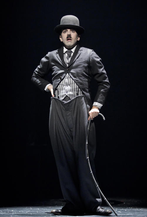 """This theater image released by Boneau/Bryan-Brown shows Rob McClure as Charlie Chaplin in a scene from """"Chaplin The Musical,"""" in New York. (AP Photo/Boneau/Bryan-Brown, Joan Marcus)"""