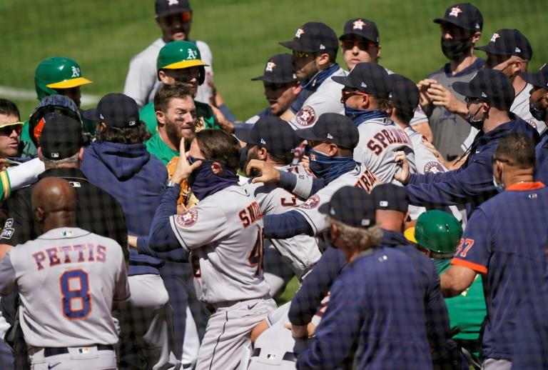 Astros, Athletics clear benches after Laureano hit