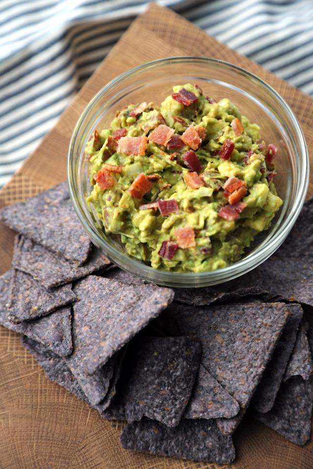 "<p>With juicy tomato, creamy guacamole, and crunchy bacon, each bite of <a rel=""nofollow"" href=""https://www.popsugar.com/food/Bacon-Guacamole-Recipe-11182387"">bacon guacamole</a> is a taste explosion! </p>"