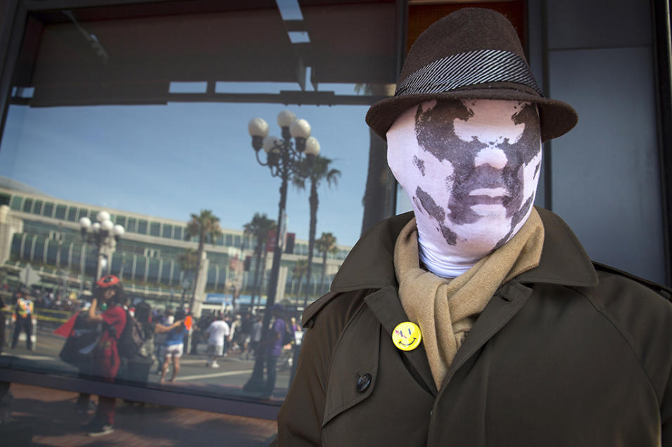 """Cosplayer Noel Victorio poses while dressed as Rorschach from the graphic novel """"Watchmen"""" during the 2013 San Diego Comic-Con International"""