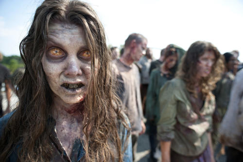 "In this image released by AMC, zombies appear in a scene from the second season of the AMC original series, ""The Walking Dead,"" in Senoia, Ga. The series' fourth season premieres on Oct. 13. Crews have been filming the new episodes in Georgia, but they keep locations of future episodes closely-guarded secrets until the shows air. In Grantville, Ga., the town's ruins were featured prominently last season. In nearby Senoia, many scenes are filmed in the historic downtown area, transforming into the fictional town of Woodbury for the show. (AP Photo/AMC, Gene Page) NO SALES"