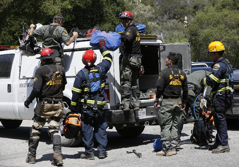 Orange County Sheriff's Technical Rescue crew gather at Trabuco Canyon Road command center during the search for missing hiker Kendall Jack, in Rancho Santa Margarita, Calif., Thursday, April 4, 2013.  A sheriff's rescue team, following the sounds of a screaming female voice, found Jack, late Thursday morning clinging to a small rock outcropping along the brush-covered wall. Jack, 18, was found not far from where her 19-year-old hiking companion, Nicolas Cendoya, had been found by a hiker Wednesday night.. (AP Photo/Damian Dovarganes)