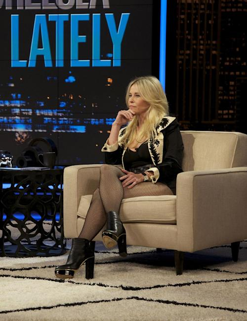 "This Oct. 18, 2012 photo released by E! shows host Chelsea Handler during a broadcast of ""Chelsea Lately,"" in Los Angeles. The role of female talk-show hosts in late-night TV network history, all 50-plus years of it, can be summed up in two words: Joan Rivers. It takes just another two _ Arsenio Hall _ to do the same for minorities. There's no indication that's going to change in the latest round of musical chairs involving ""Tonight"" and ""Late Night."" (AP Photo/E!, Micah Slay)"