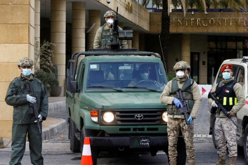 FILE PHOTO: Jordanian army members guard outside a hotel that was transformed into a quarantine station in Amman
