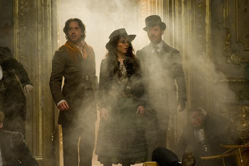 "In this film image released by Warner Bros. Pictures, from left, Robert Downey Jr., Noomi Rapace, and Jude Law are shown in a scene from ""Sherlock Holmes: A Game of Shadows."" (AP Photo/Warner Bros. Pictures, Daniel Smith)"