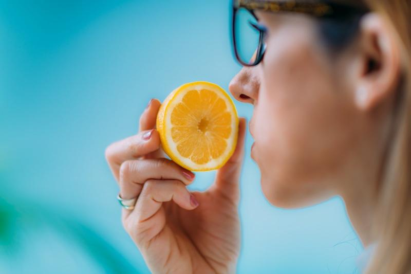 Woman Trying to Sense Smell of a Lemon