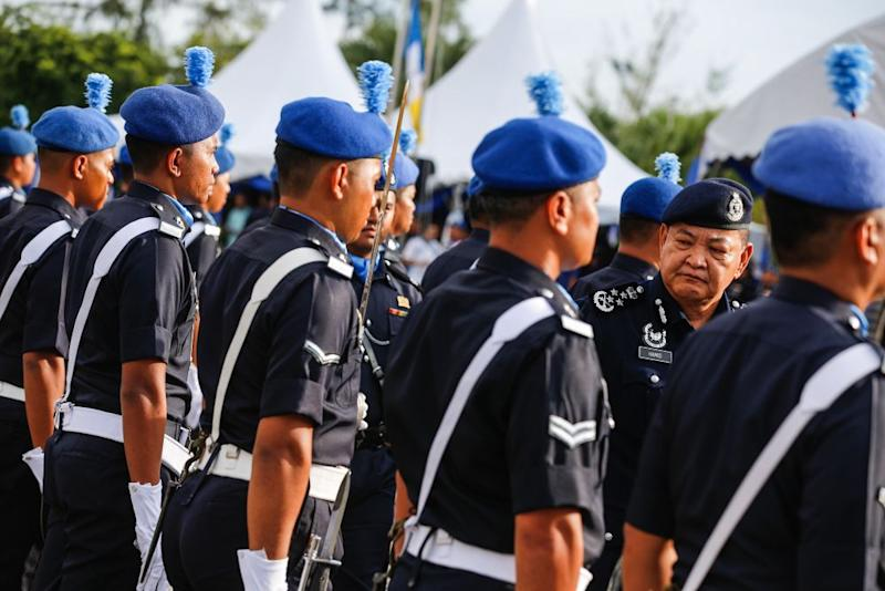 Inspector-General of Police Tan Sri Abdul Hamid Bador inspects a police squad at the Marine Police headquarters in Batu Uban, George Town October 10, 2019. — Picture by Sayuti Zainudin
