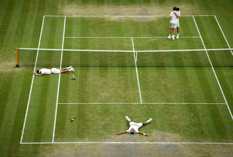 LONDON, ENGLAND - JULY 13: Sebastian Cabal of Colombia and playing partner Juan Robert Farah of Colombia celebrate match point in their Men's Doubles final against Nicolas Mahut of France and Edouard Roger-Vasselin of France during Day twelve of The Championships - Wimbledon 2019 at All England Lawn Tennis and Croquet Club on July 13, 2019 in London, England. (Photo by Matthias Hangst/Getty Images)