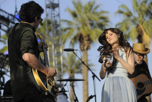 FILE - This April 16, 2010 file photo shows M. Ward, left, and Zooey Deschanel of the band She & Him performing during the first day of the Coachella Valley Music and Arts Festival in Indio, Calif. Deschanel says she doesn't draw from her personal life when she creates, and instead relies on her own healthy imagination. (AP Photo/Chris Pizzello, file)