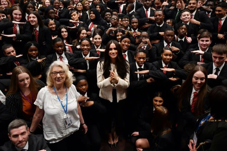 Meghan drew shrieks of delight from schoolchildren during an unannounced school visit Friday in Dagenham, east London