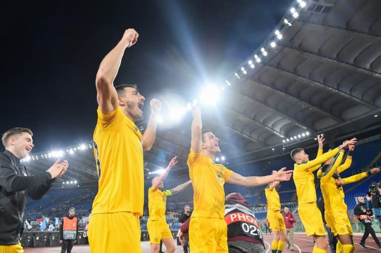 Roman conquerors: Celtic players celebrate a 2-1 win over Lazio in the Italian capital