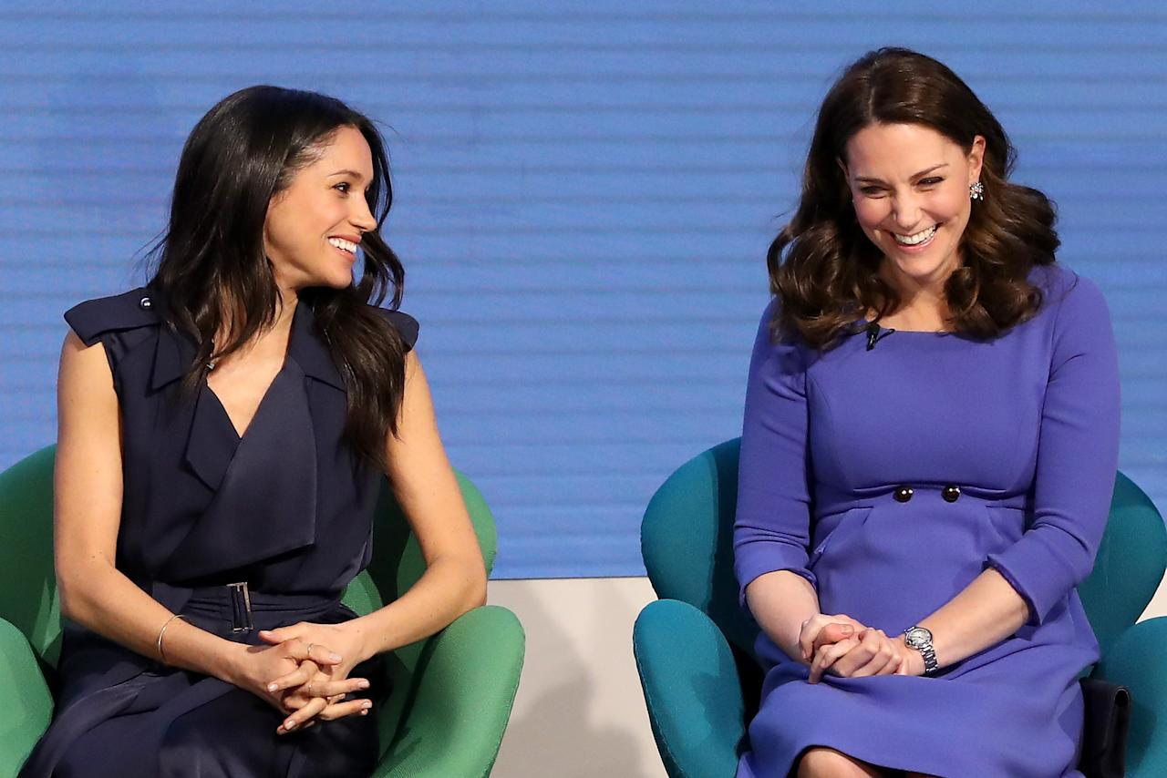 <p>Meghan and Kate share a giggle as they attend the first annual Royal Foundation Forum in February (Getty) </p>