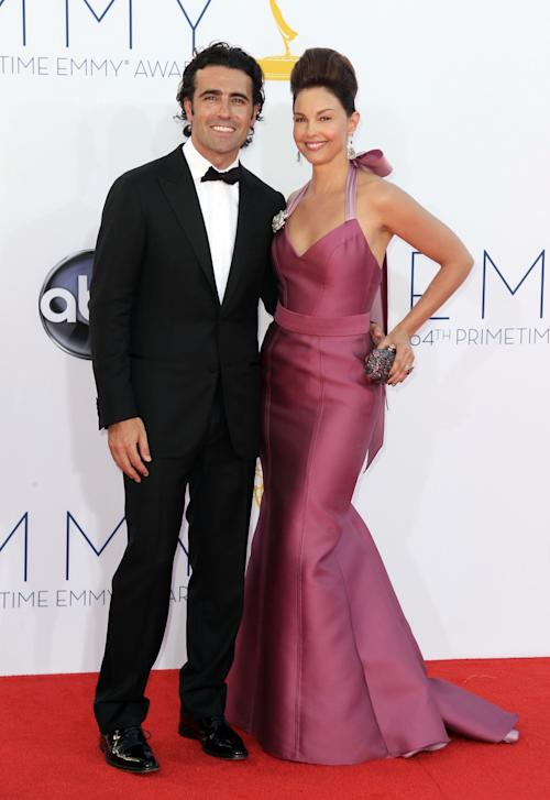 FILE - In this Sept. 23, 2012 file photo, actress Ashley Judd, right, and her husband, Dario Franchitti, arrives at the 64th Primetime Emmy Awards at the Nokia Theatre, in Los Angeles. Judd's spokeswoman confirmed a Tuesday, Jan. 29, 2013, report from People that the 44-year-old actress and 39-year-old Scottish race car driver are ending their marriage. (Photo by Matt Sayles/Invision/AP, File)