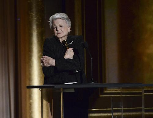 Actress and honoree Angela Lansbury reacts after receiving an award at the 2013 Governors Awards on Saturday, Nov. 16, 2013 in Los Angeles. (Photo by Dan Steinberg/Invision/AP)