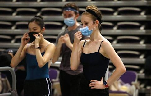 Putting on a mask is now part of the training routine for Jessica Burrows. Photo: Nora Tam