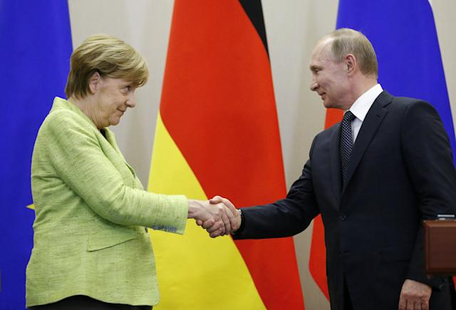 FILE PHOTO: Russian President Vladimir Putin and German Chancellor Angela Merkel shake hands during a joint news conference following their talks at the Bocharov Ruchei state residence in Sochi, Russia, May 2, 2017. REUTERS/Alexander Zemlianichenko/File Photo