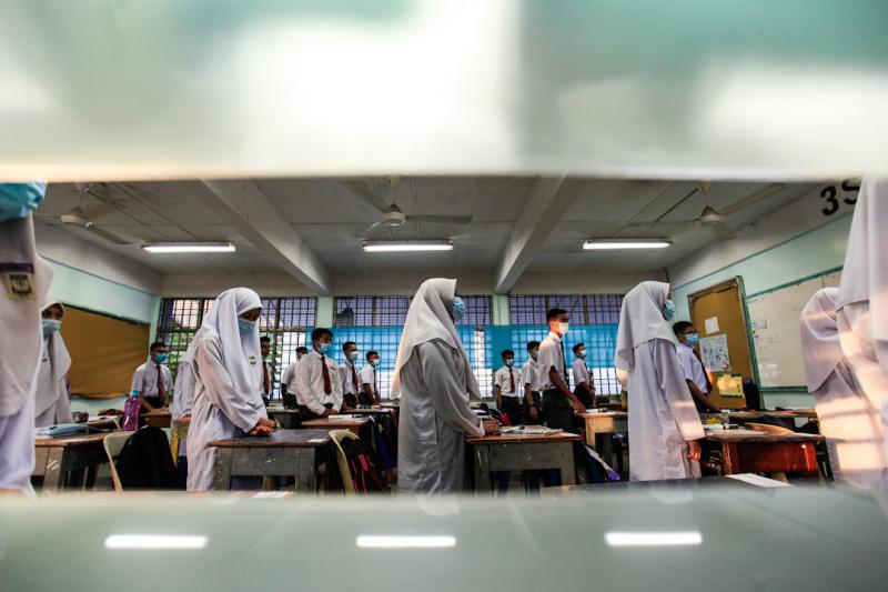 Sekolah Menengah Kebangsaan Raja Tun Uda students on their first day back at school in Bayan Lepas July 15, 2020. — Picture by Sayuti Zainudin