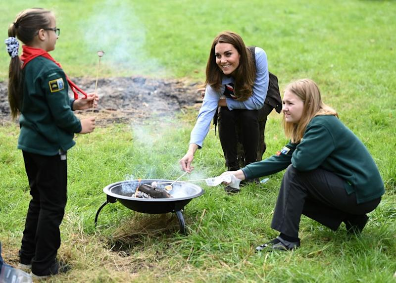 The Duchess of Cambridge roasted marshmallows with a group of scouts in west London. (Photo by Daniel Leal-Olivas - WPA Pool/Getty Images)