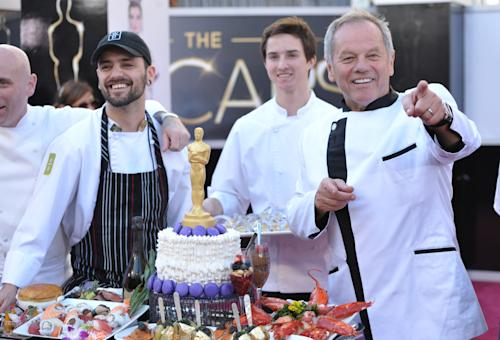 Celebrity chef Wolfgang Puck displays a platter of food the 85th Academy Awards at the Dolby Theatre on Sunday Feb. 24, 2013, in Los Angeles. (Photo by John Shearer/Invision/AP)