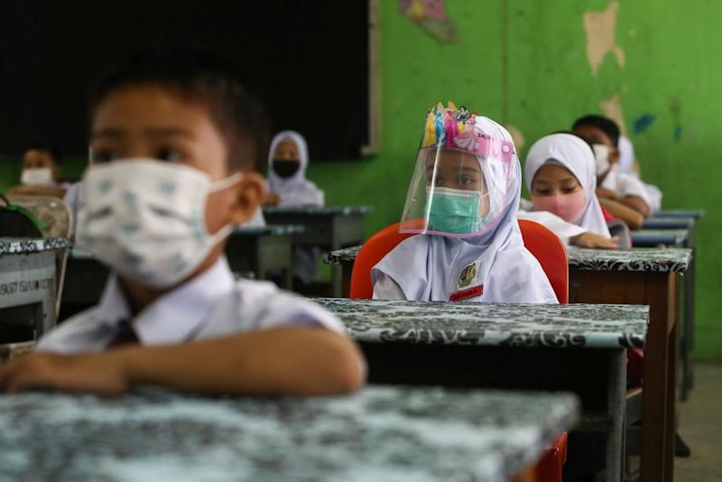 Sekolah Kebangsaan Section 7 students on their first day back at school in Shah Alam July 22, 2020. — Picture by Yusof Mat Isa
