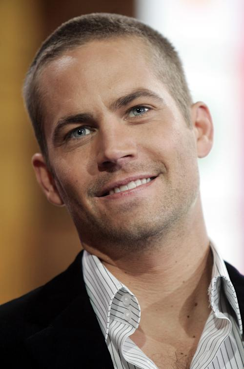"""FILE In this Feb. 14, 2006 file photo, actor Paul Walker, appears on stage during a taping for MTV's 'Total Request Live' show at the MTV Times Square Studios in New York. Walker is in New Orleans for the making of the suspense thriller, """"Hours."""" The film is about a father struggling to keep his newborn daughter alive in a New Orleans hospital ravaged during Hurricane Katrina. """"The Fast and the Furious"""" star plays the role of Nolan, a father trying to keep his daughter alive in an incubator through power outages, rising water and descending chaos. """"Hours"""" will be filming in New Orleans and other parts of Louisiana for about a month. (AP Photo/Jeff Christensen, file)"""